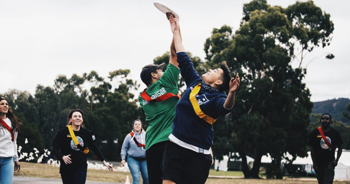 Two young people playing frisbee
