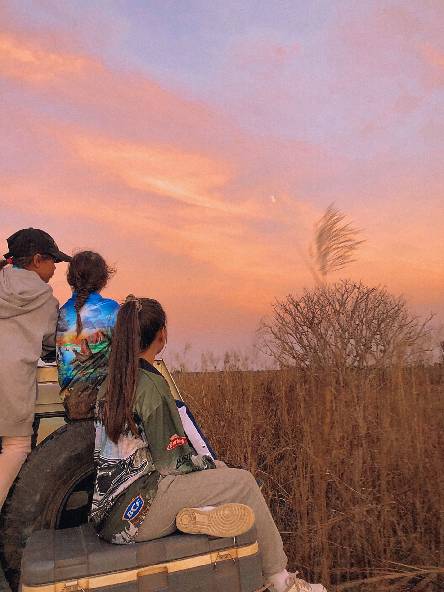 Ardu with her family looking out at the sunset